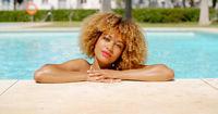 Beautiful Girl Chilling in Swimming Pool
