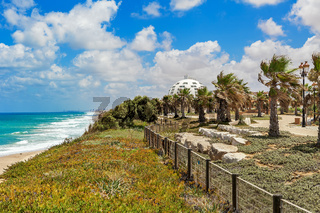 View on promenade with palms along Mediterranean sea coastline in Ashqelon