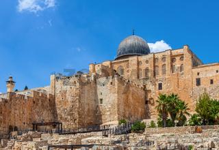Ancient walls and Al Aqsa Mosque dome in Jerusalem, Israel.