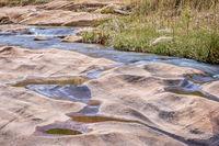 stream flowing over sandstone