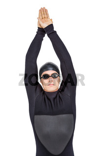 Swimmer in wetsuit while diving