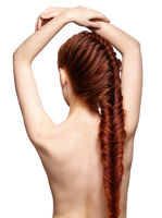 Woman with ginger braids hair-do from back side isolated on white