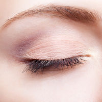 Closeup shot of female face makeup with closed eyes