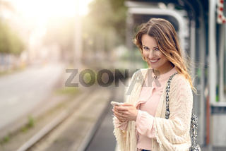 Attractive woman waiting on a platform