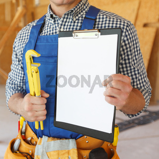Workman with wrench and contract