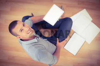 Young creative businessman using his tablet