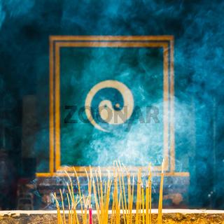 Burning incense with Yin Yang symbol