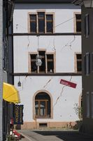 Uplift cracks on a house facade due to geothermal drilling in theold town of Staufen