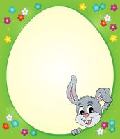 Egg shaped frame with lurking bunny 1 - picture illustration.