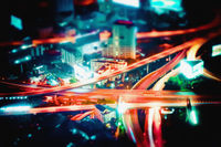 Blurred abstract futuristic night cityscape view. Bangkok, Thailand