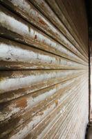 grunge metallic roller closed shutter of  shop