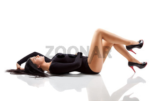 Young woman with a stunning body lying on floor