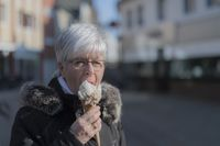 An elderly lady with a serving of ice cream