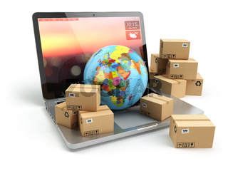 Shipping, delivery and logistic concept. Earth and cardboard boxes on laptop keyboard. Online technology.