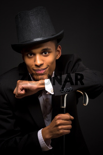 Handsome man in top hat posing with cane
