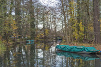 Covered with canvas boats in the Spree forest