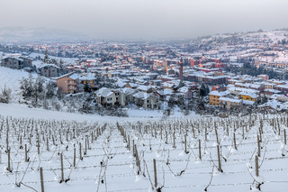 Town of Alba among wintry hills.
