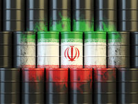 Iranian oil fuel energy concept. Iranian flag painted on oil barrels.