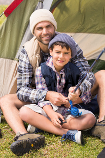 Father and son in their tent