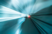 Abstract traffic background. Modern tunnel with blurred light tracks. Motion blur