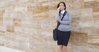 Woman using phone and waiting on hold