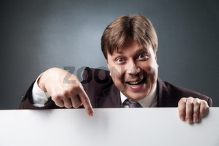 Adult businessman pointing at blank space