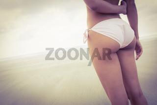 Fit woman in bikini looking to sea