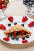 fruit pancake on white plate