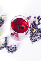 Glass of aronia juice with berries, overhead view