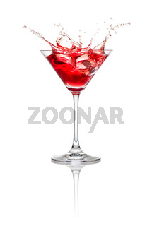 Red cocktail with ice cubes and splash