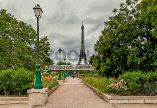 Urban park and Eiffel Tower in Paris, France.