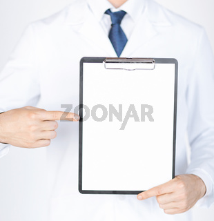 doctor pointing at blank white paper