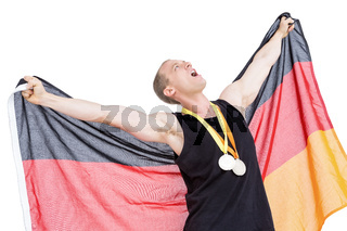 Athlete posing with olympic gold medals around his neck
