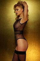 Sexy curvaceous young blond woman