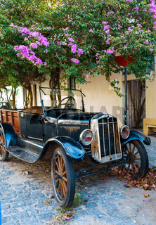 Cobblestone street and old car in Historic neighborhood in Colonia del Sacramento, Unesco World Heritage town, Uruguay.