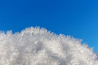 Ice mist in front of blue sky