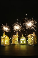 Small ceramic houses with lights and sparklers