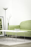 green sofa in a white room