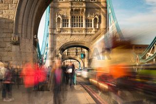 Fast moving people and traffic on Tower Bridge, London, United Kingdom
