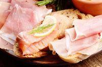 Open sandwiches with salmon and jamon