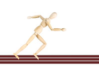 Sportsman running on the tracks isolated over white background. Abstract image with a wooden puppet