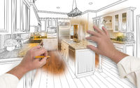 Male Hands Sketching Custom Kitchen with Photo Showing Through