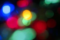 Blurred lights with bokeh effect. Vintage Background Abstract Defocused Lights.
