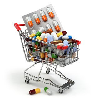 Pharmacy medicine concept. Shopping cart with pills and capsules.