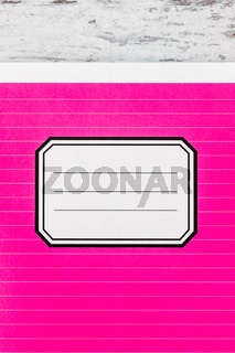 Pink Notebook with Name Label on Cover