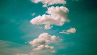 Toned image of the sky and clouds in line, old film photo imitation
