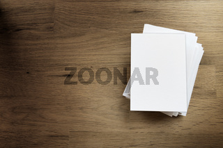 Blank paper card on wooden table