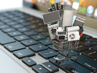 E-commerce or online shopping concept. Home appliance in shopping cart on the laptop keyboard.