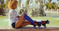 Sexy Girl Adjusting Her Roller Skates