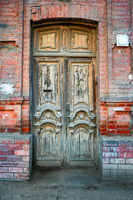 Detail of the facade with vintage wooden door in Astrakhan, Russia